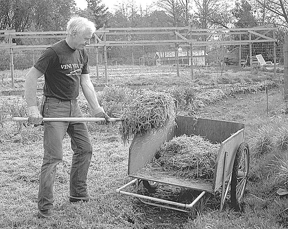 Bob Gregson throwing hay 10 keys to small farm success